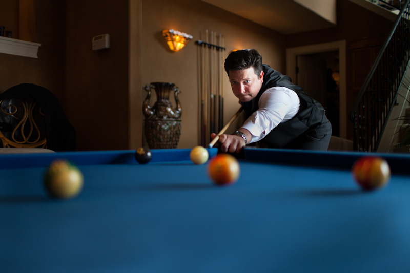 groom playing pool before wedding