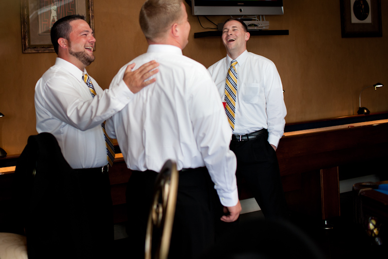groomsmen laughing getting ready