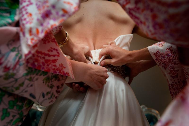 ziping up brides dress