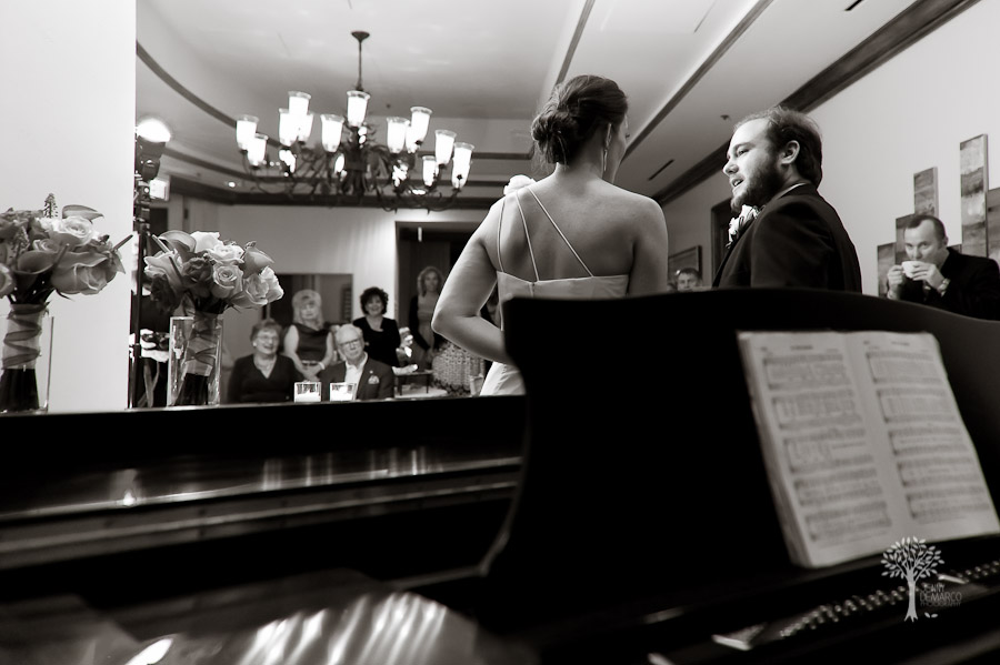 the bride and groom sang to their guests at the reception, four seasons, austin wedding photographer, piano