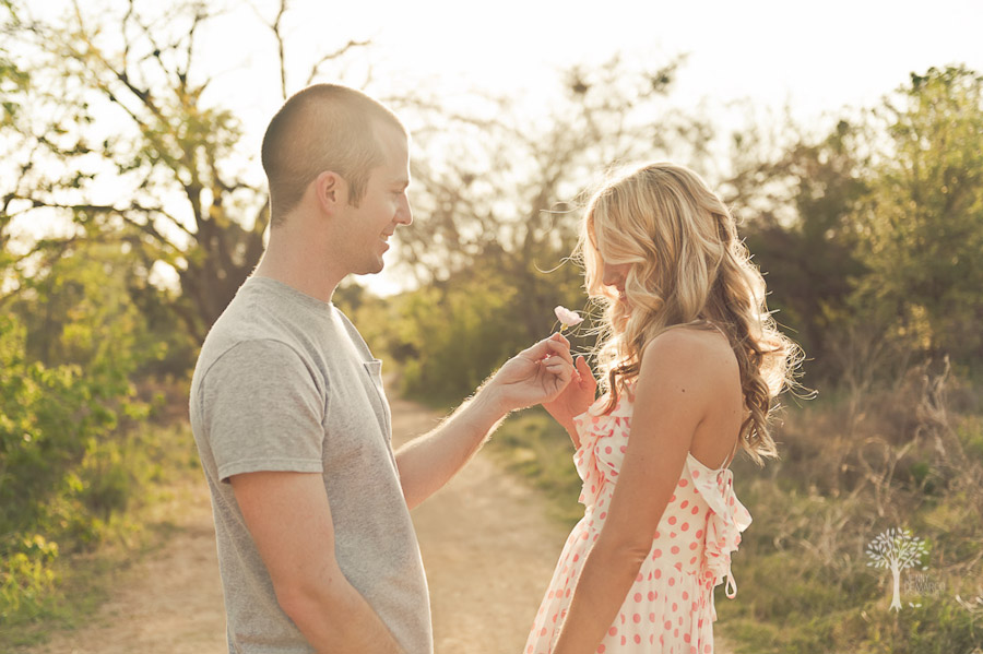 Pink buttercup flower, gift, soft, girly, flirty engagement session, wedding photographer, austin wedding photographer