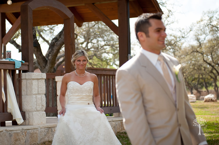 Ashlee and Ray's first look. Wedding photography by Jenny DeMarco. Austin Wedding Photographer, Bride is wearing a casa blanca dress, groom is wearing a tan suite