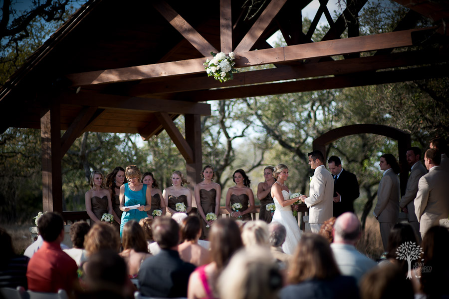 married under a pavilion in New Braunfels during and outdoor ceremony, sunset ceremony, New Braunfels Wedding Photographer, readings, wedding ceremony, boulder springs,