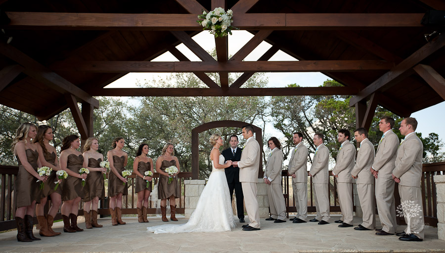Outdoor wedding ceremony in new braunfels, central texas, hill country, pavilion, wedding party, oak trees, copper, bridesmaids dresses, boots, cowboy, country chic,