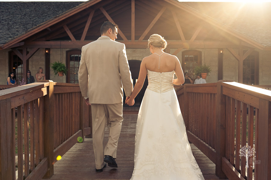 Man and Wife. walking across the bridge, river, creek, hill country, outdoor wedding, New Braunfels Wedding Photographer