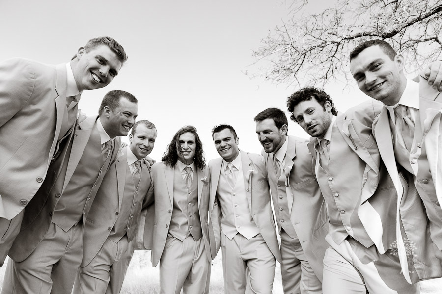 football huddle, groomsmen portrait, black and white, Photojournalist, wedding photography, documentary