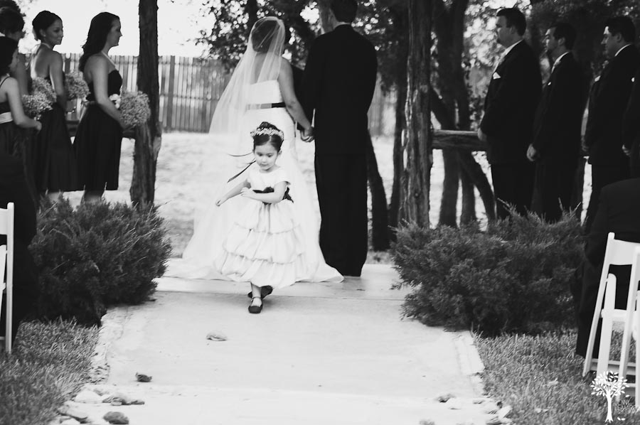 Texas Old Town, Flower girl, black and white wedding, flower petals, down the aisle, ruffled dress, Mia Garza, John McCord