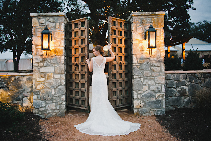 bridal portrait at the beautiful wooden doors into the courtyard at the Vineyards of Chappel Lodge