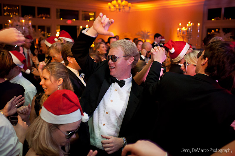 The guests having a good time and big party. Christmas hats were worn to celebratet the season in style