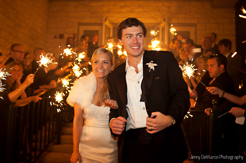 The bride and groom exit thier wedding reception through sparklers