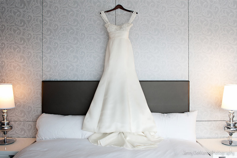 Gorgeous wedding gown hanging at The W Hotel in their stylish and trendy hotel room.