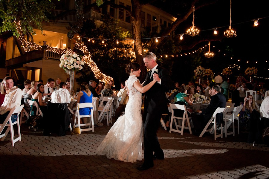 First dance on the patio at the Allan House underneath century oak trees and magical lights.