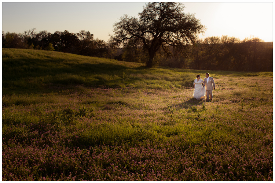 Bride and groom in field in La Grange, Texas near the Czech Heritage Center and Fair Grounds