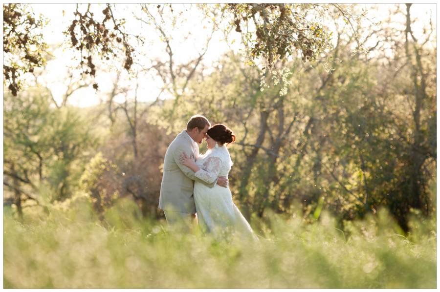 bride and groom portrait in the field near Round top