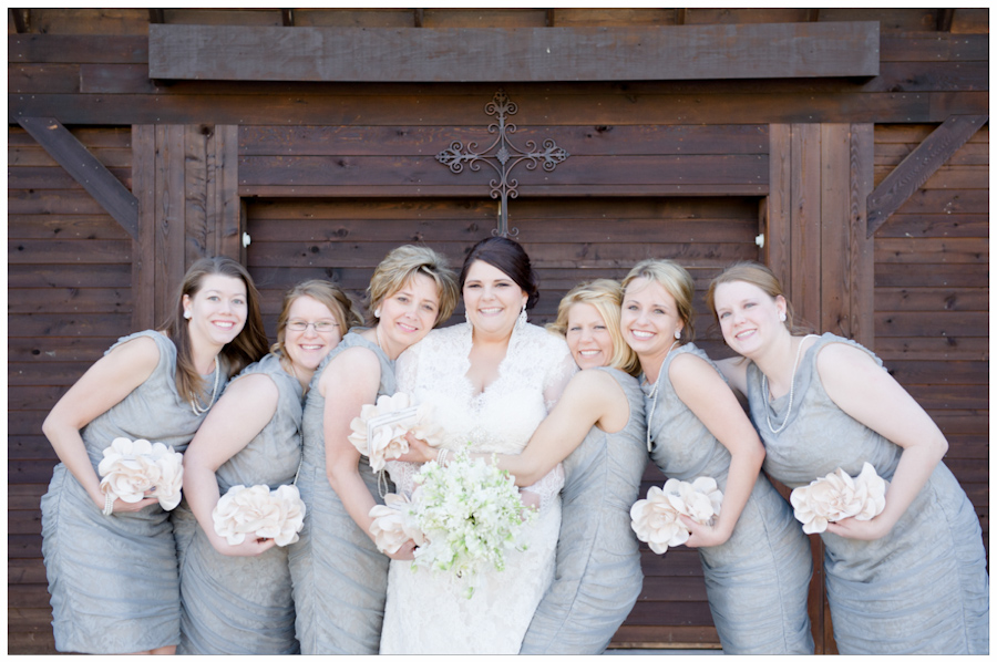 bridal party in grey dresses with pink floral clutches