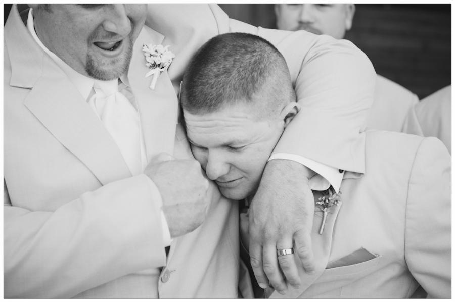 groom giving groomsmen a knuckle noogie