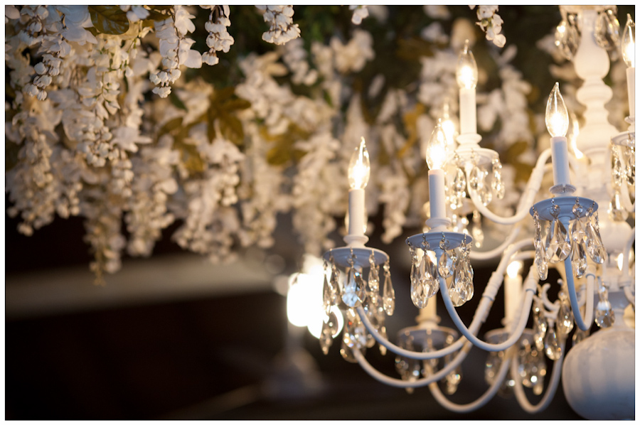 chandiler and white florals hang from the La Grange Fair grounds dance hall and pavillion