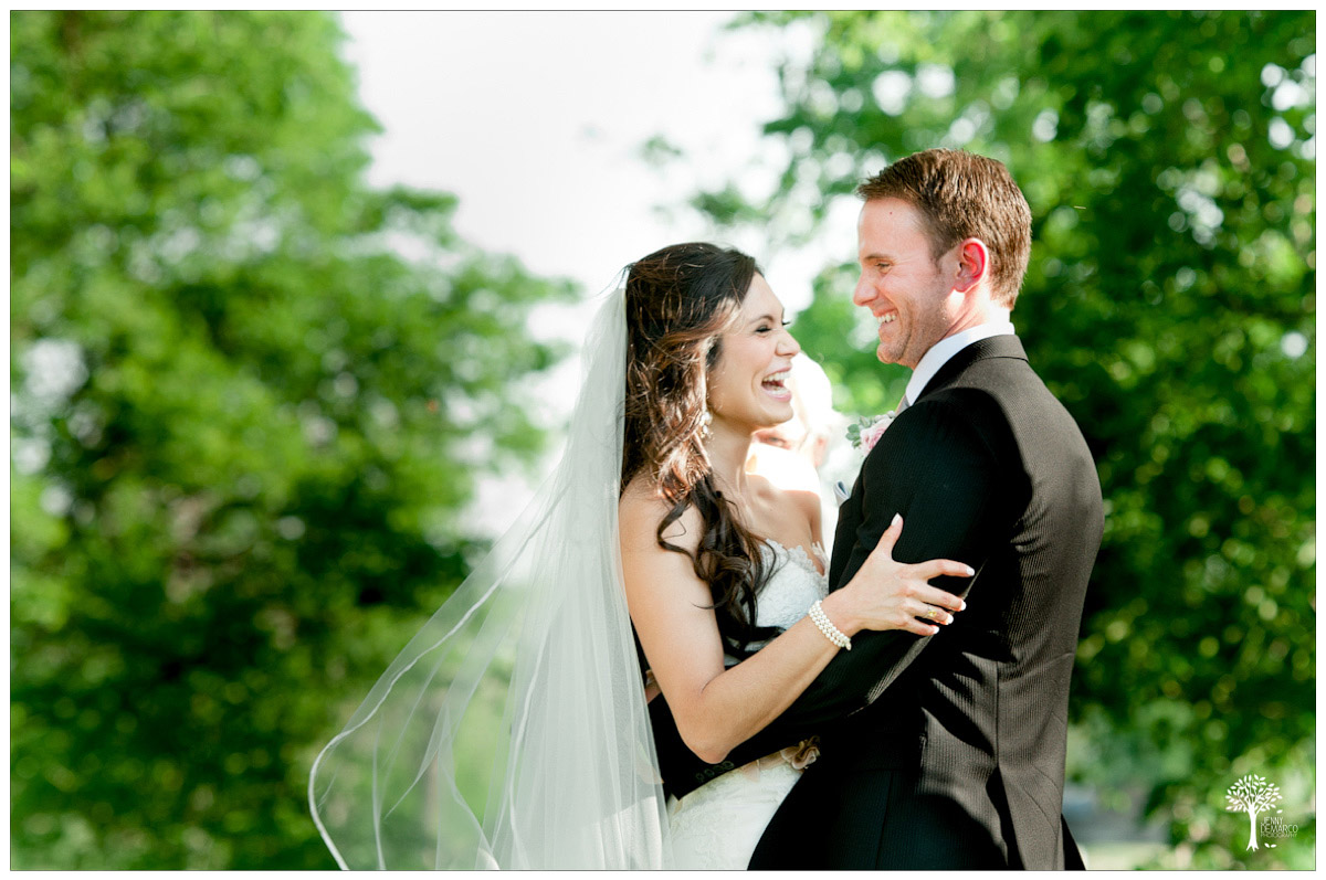 bride and groom elated during garden outdoor ceremony