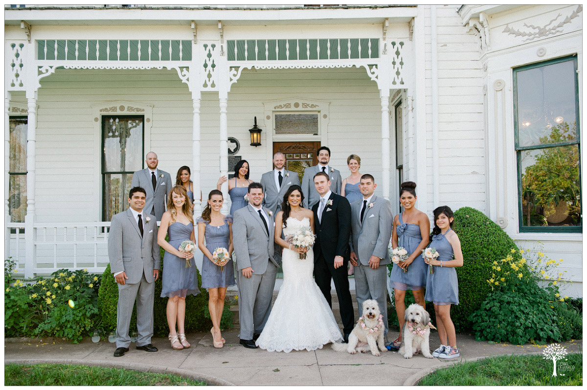 Bridal party in front of historic victorian gingerbread mansion near Austin, Texas
