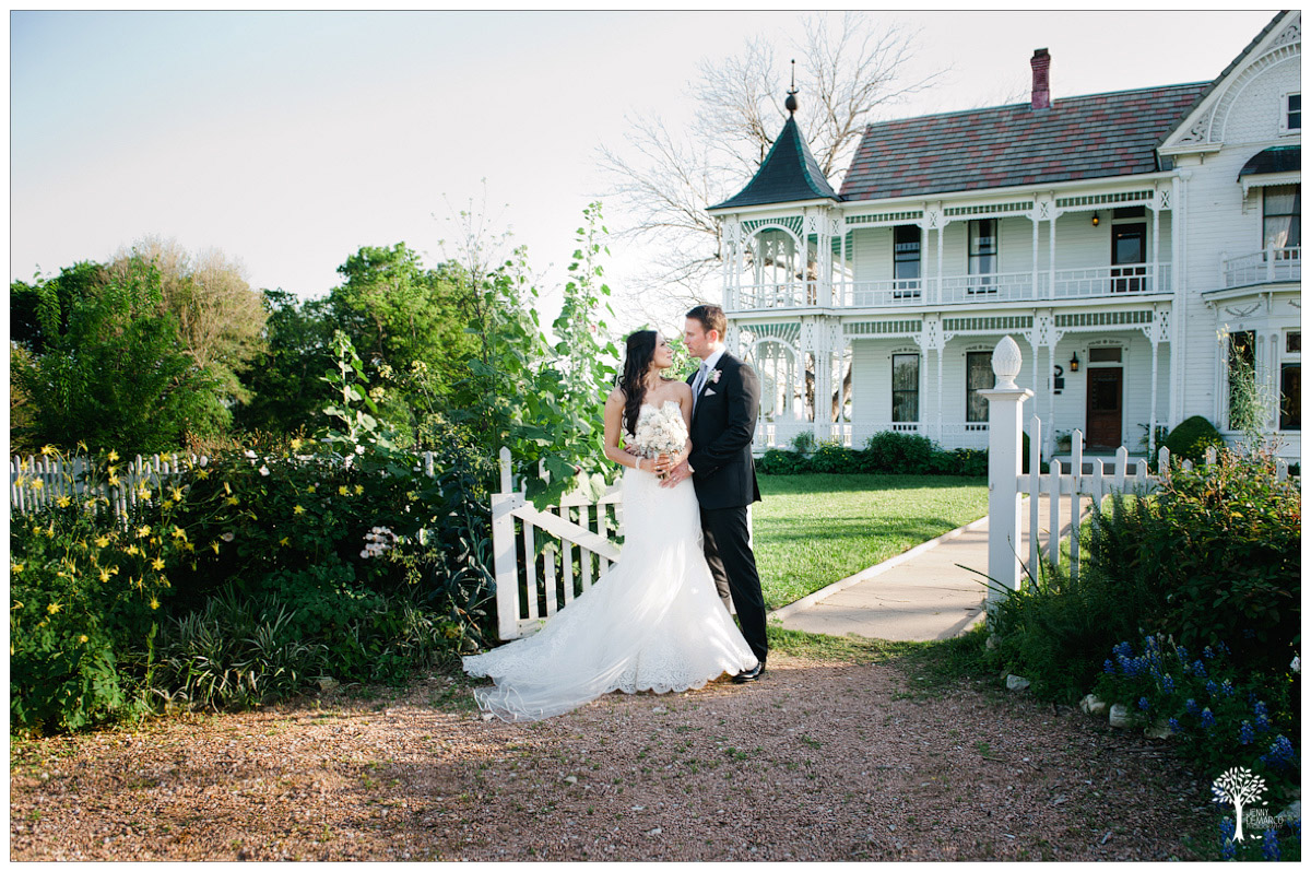Bride and groom in front of the Barr Mansion
