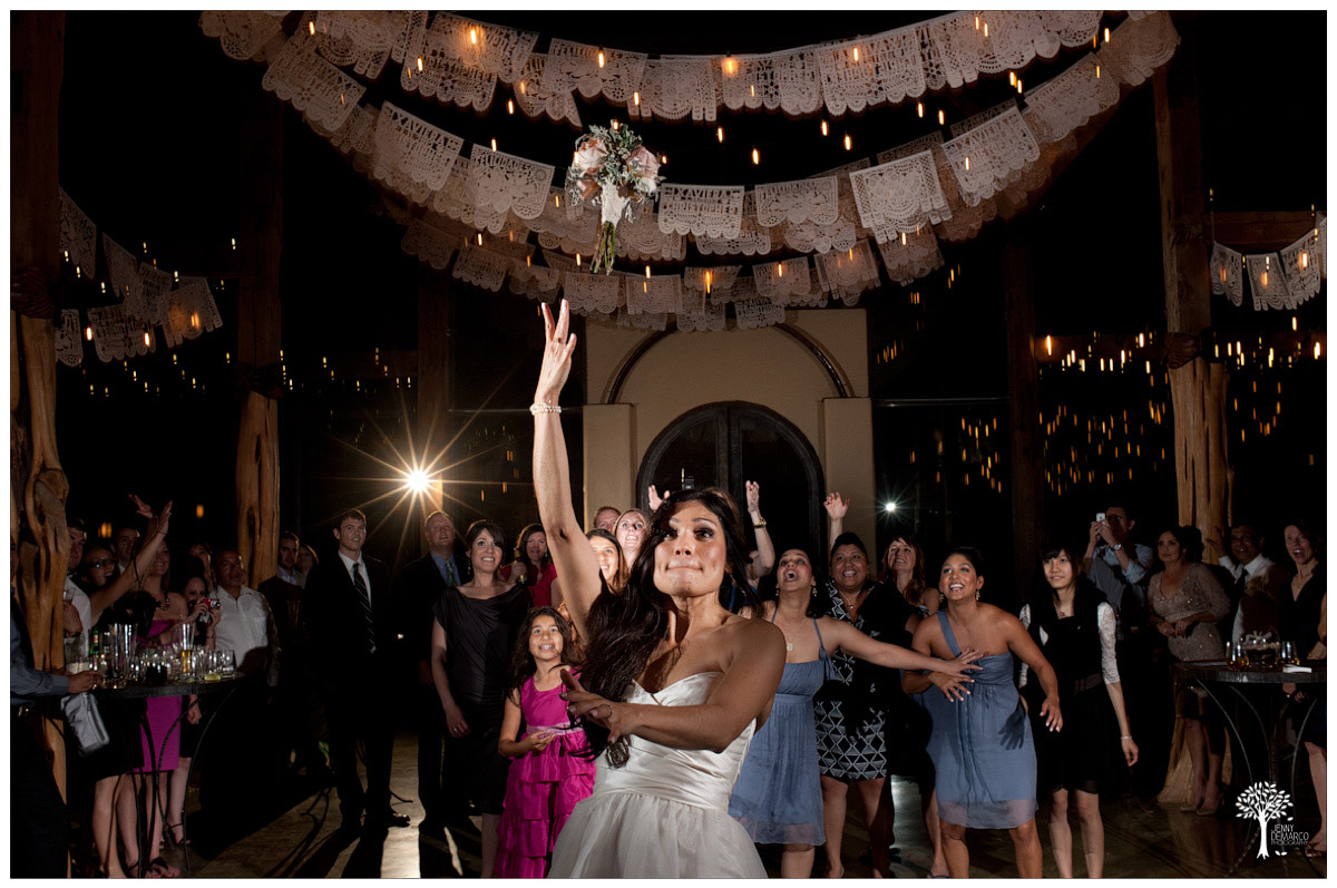bouquet toss with papel picado wedding decorations