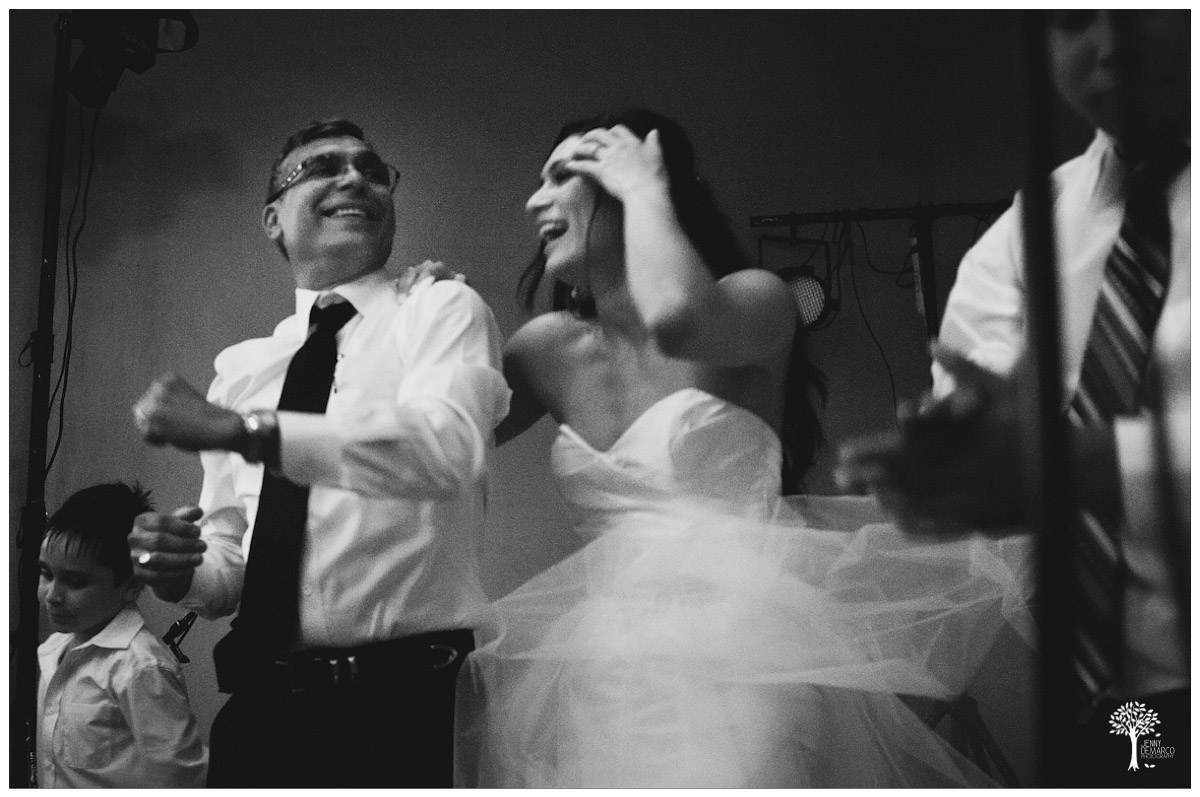 bride dancing with her dad on stage
