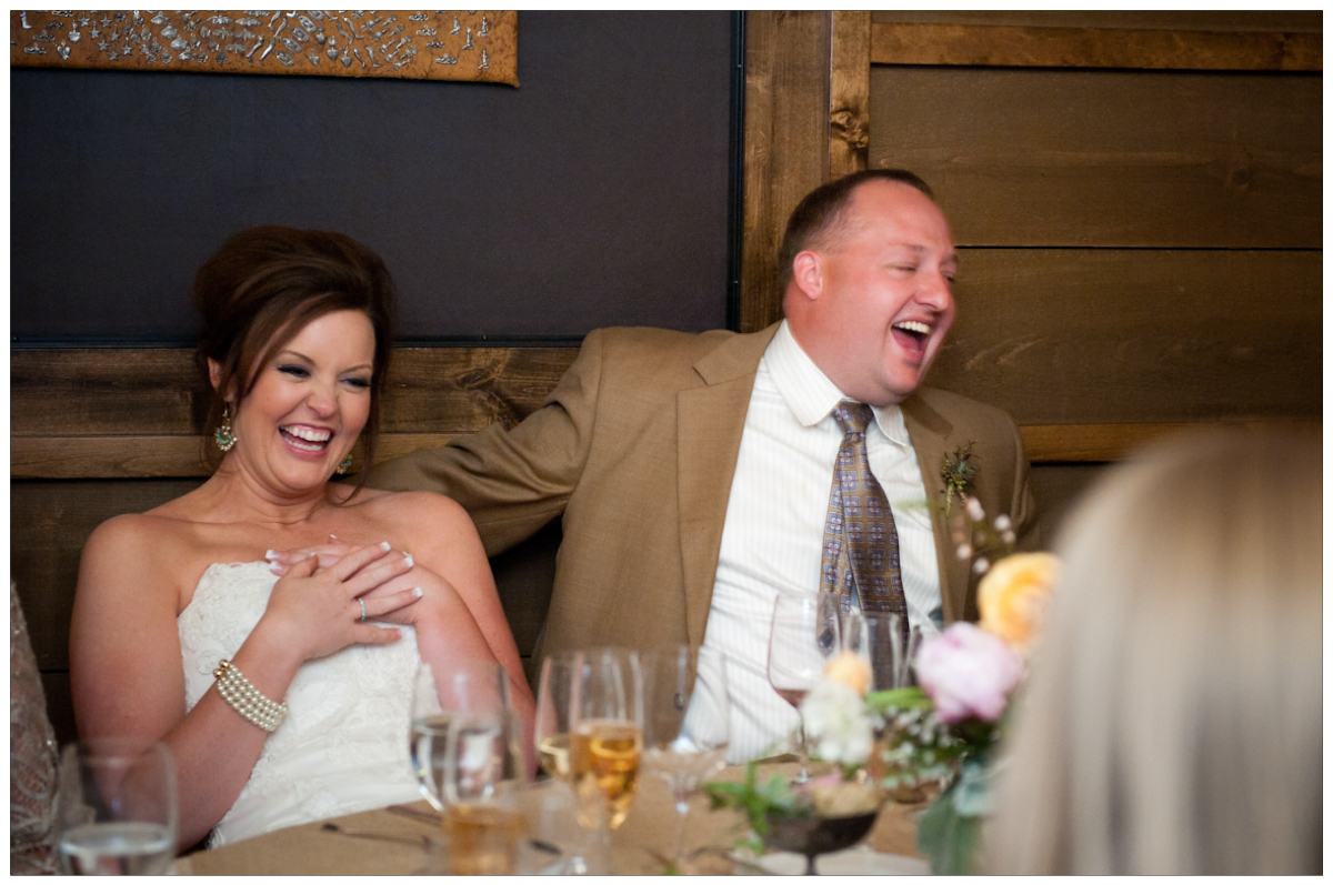 bride and groom cracking up lauging the the guests mad libs