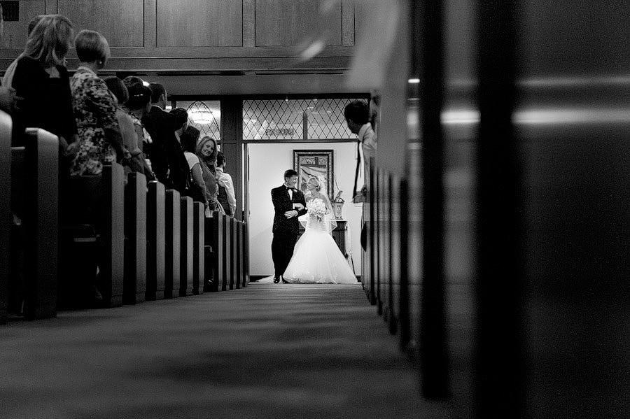 doors open for the first time as bride and dad walk down the aisle