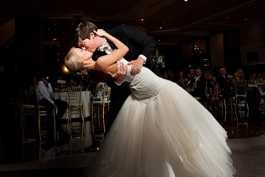 Lead singer of Waterloo Revial, dips his bride at the end of their first dance at their wedding reception in downtown Austin, Texas