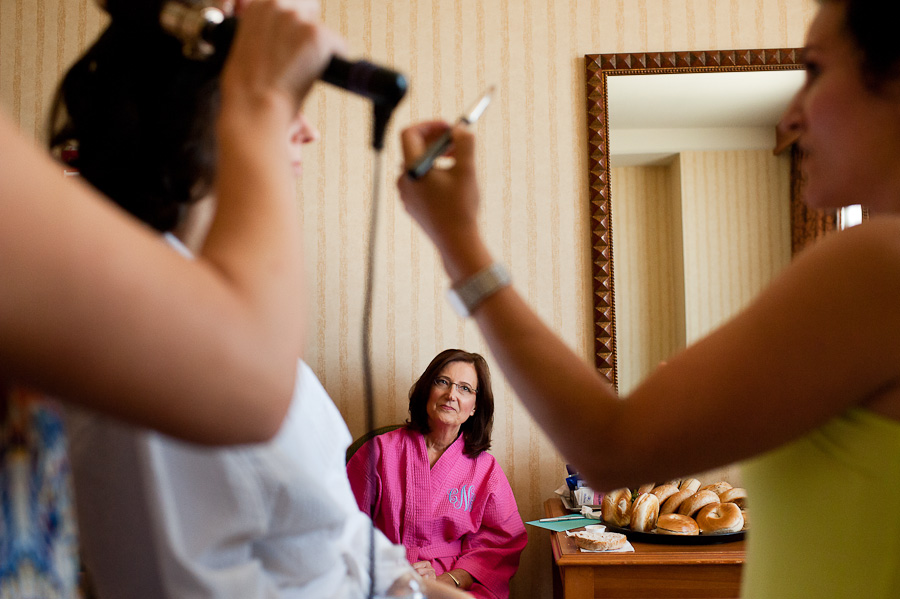 mother watching daughter get ready