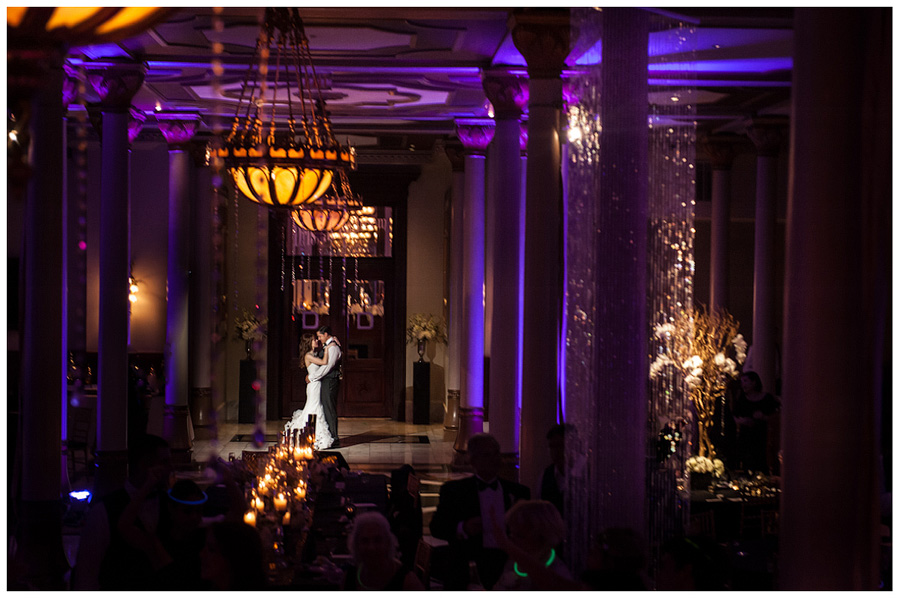 bride and groom dancing on the mezzanine of the driskill