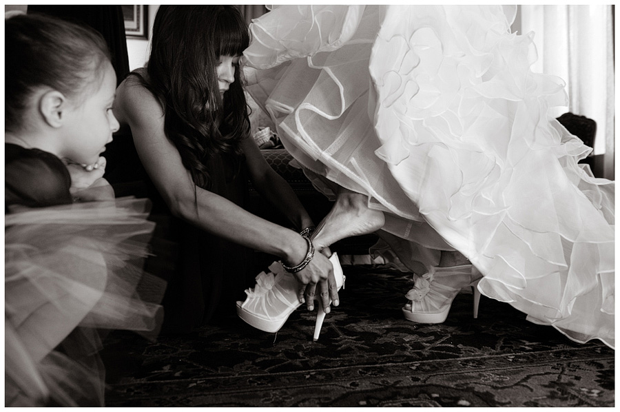 bride putting shoes vera wang white collection