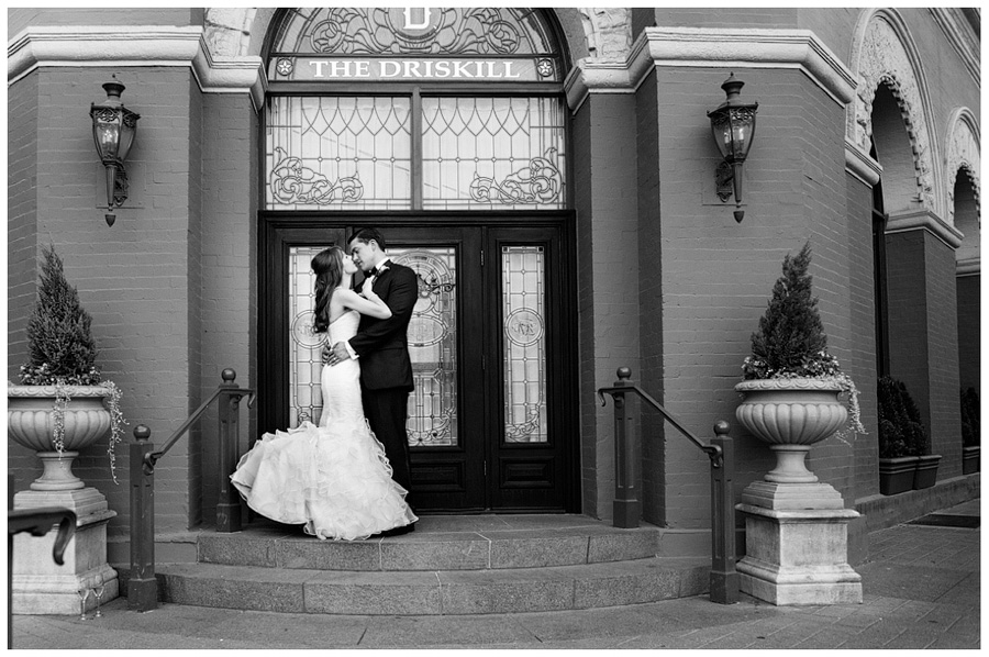 bride and groom infront of the driskill cafe doors
