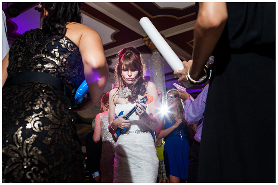 bride playing air guitar