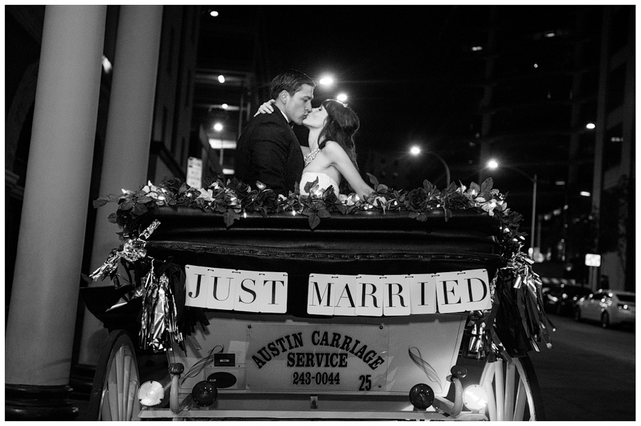 just married carriage ride in the city