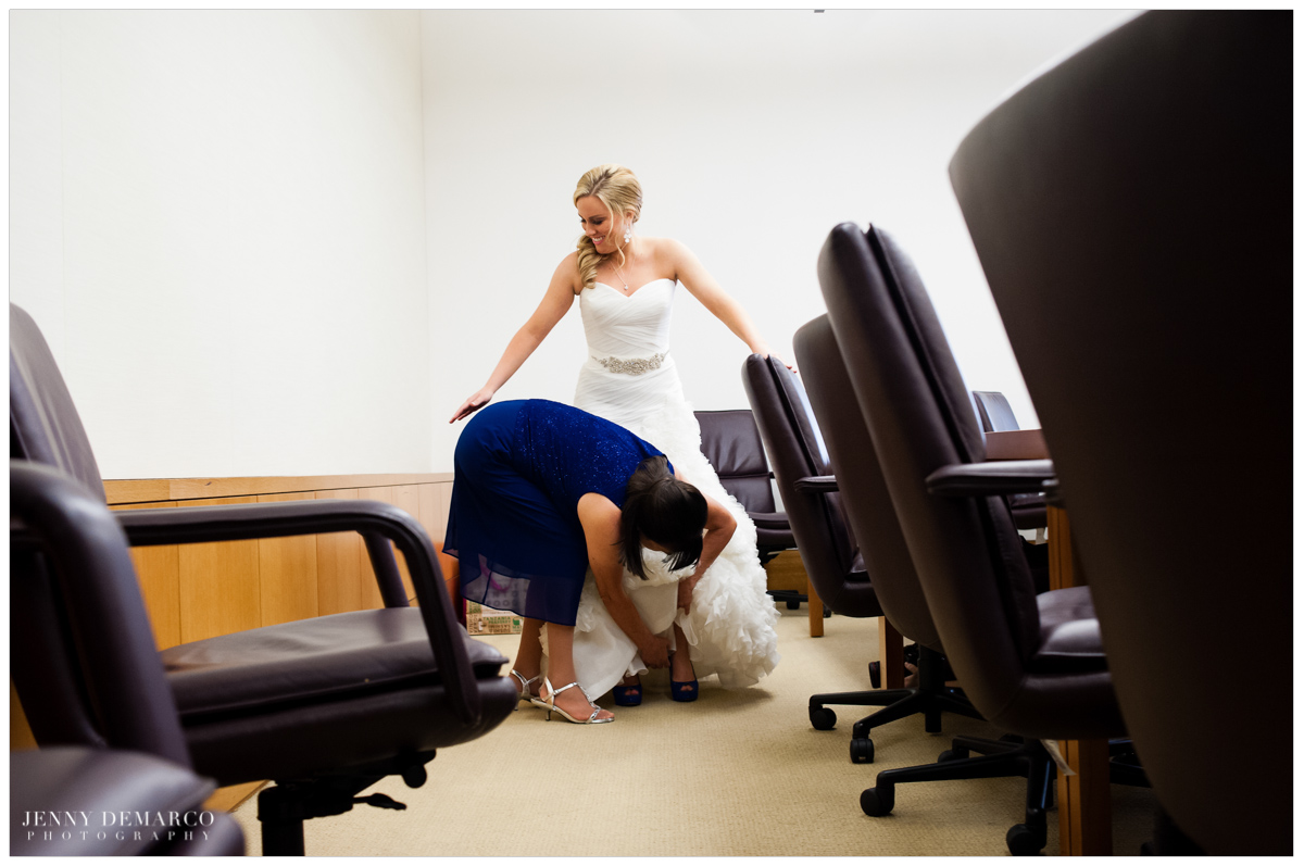 mom helping bride put on shoes, funny fearless moment during a wedding