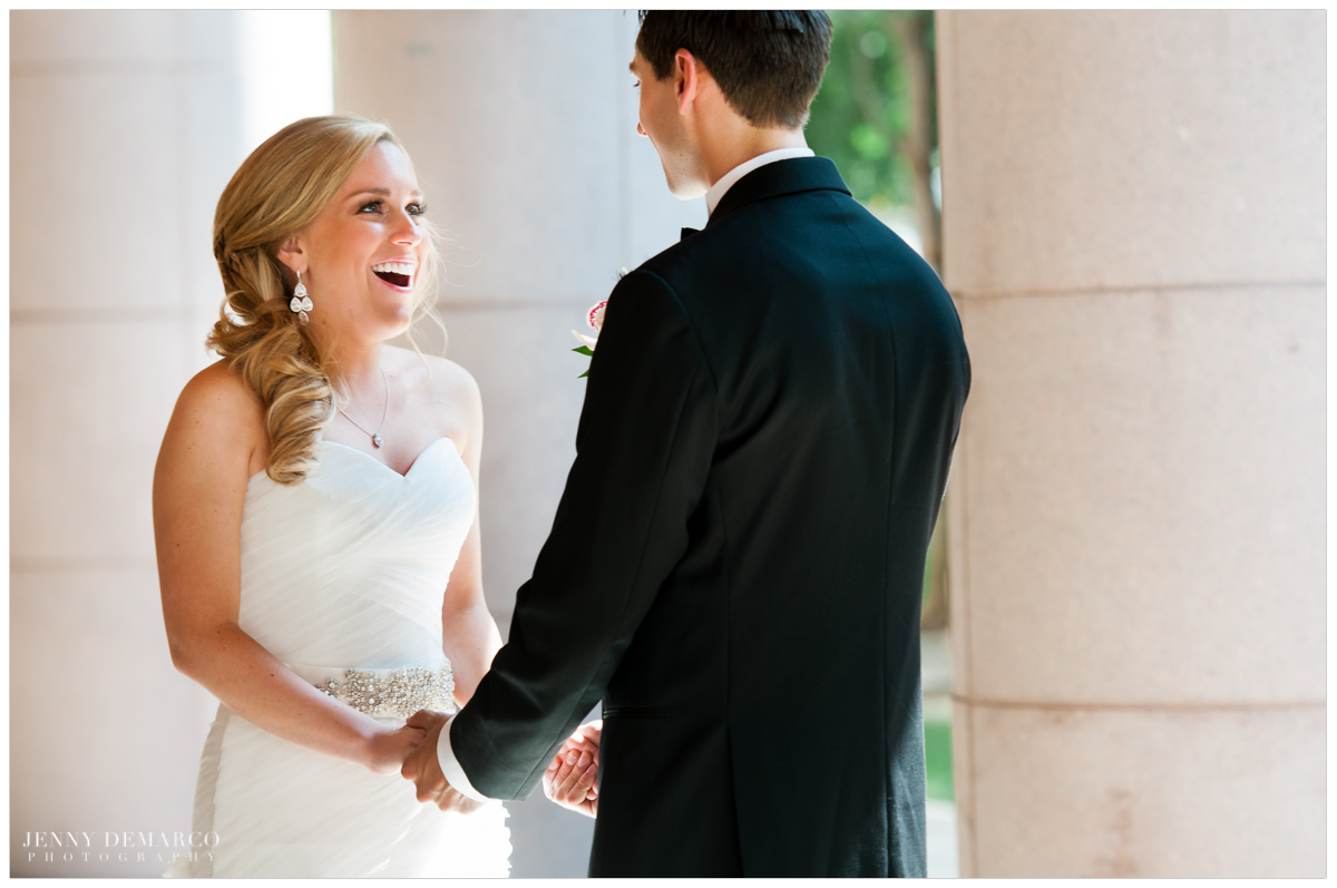 Brides reaction during first look on University of Texas campus in Austin