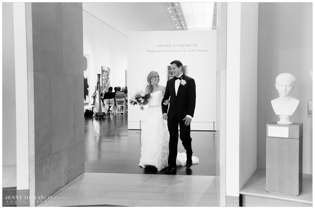 Bride and groom exit gallery of art museum