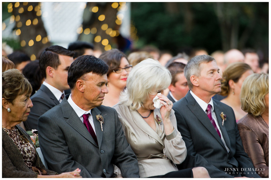 mother of the groom wipes tear away during emotional ceremony