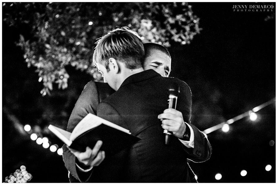 bromance best man giving tearful toast and hug to the groom