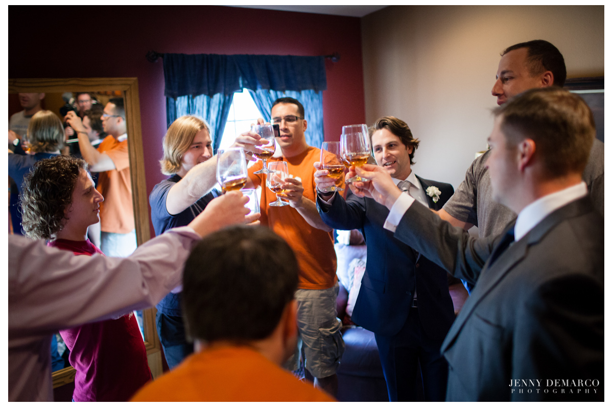 The groomsmen cheersing to the groom before the wedding begins.