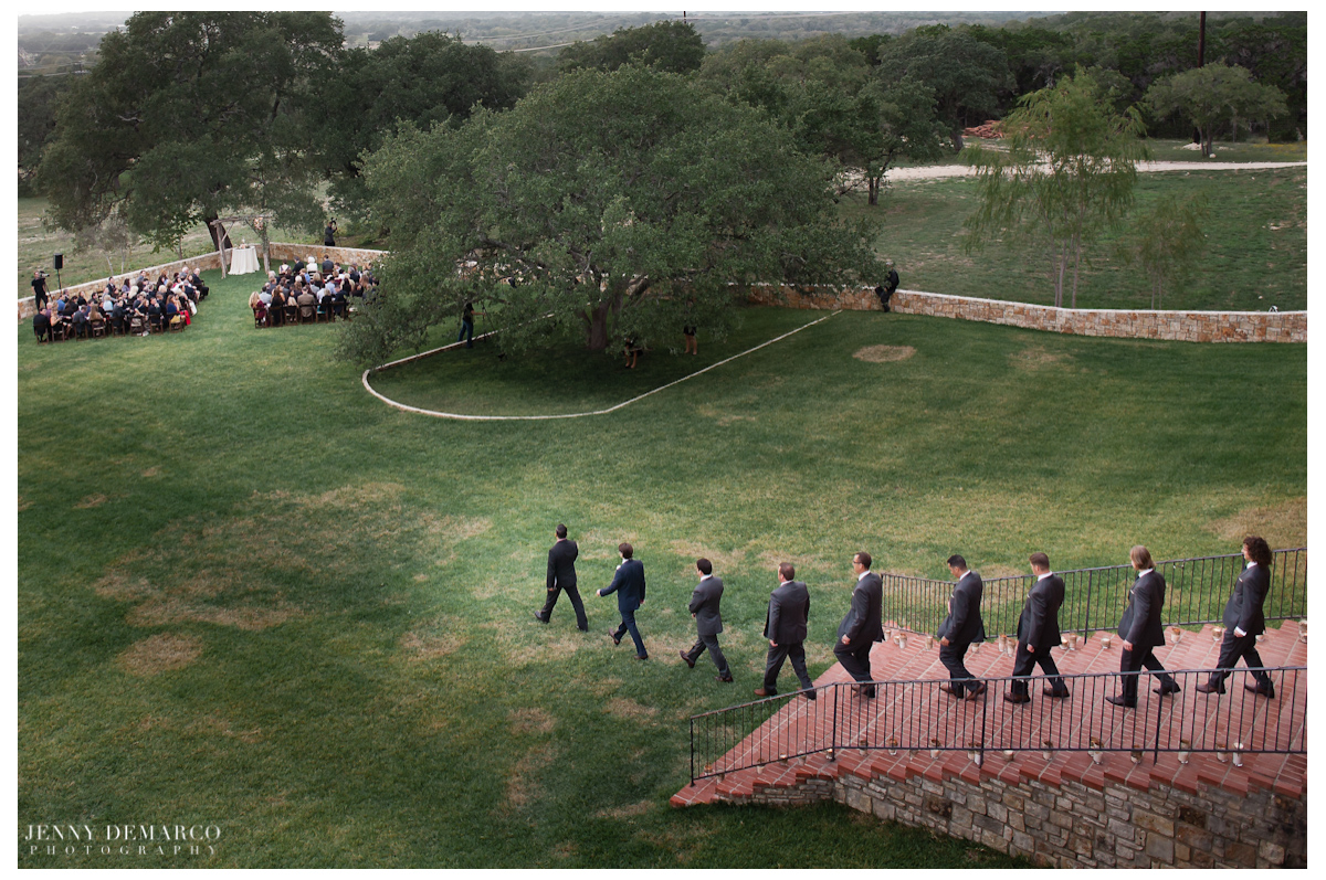 The groom and groomsmen walking out to the wedding.