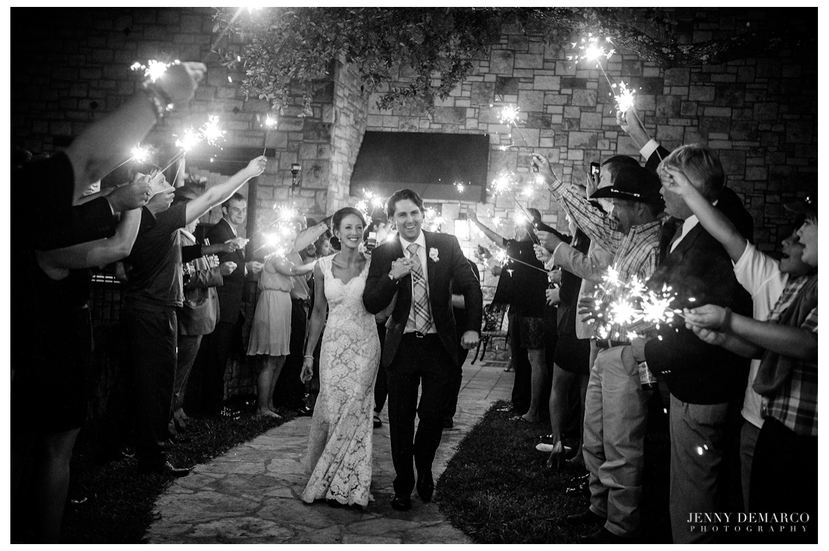 The guests sending off the newlyweds with sparklers.