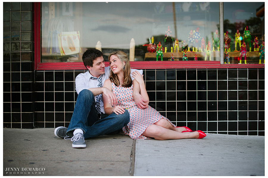 couple sitting in front of boutique on South Congress