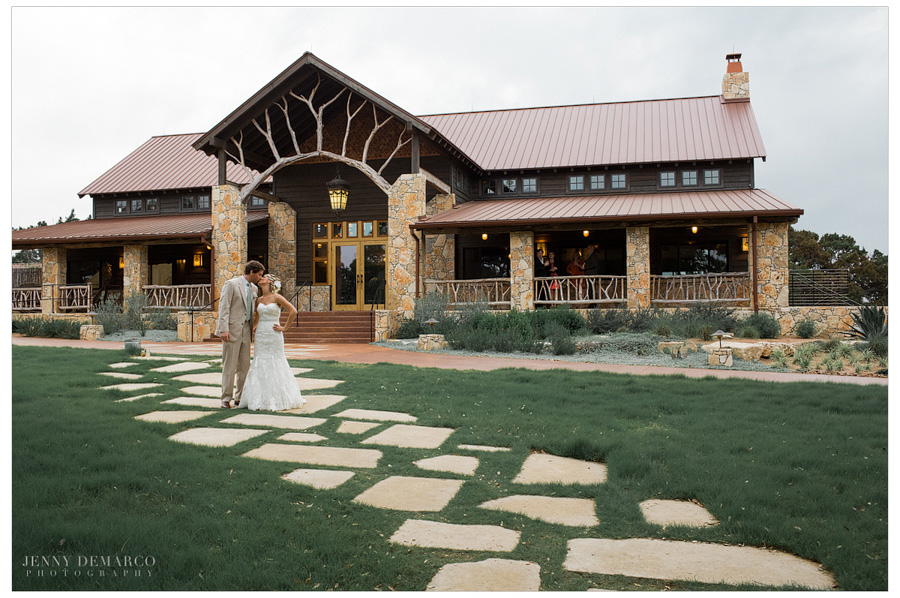 Bride and groom in front of the Events hall at Camp Lucy.