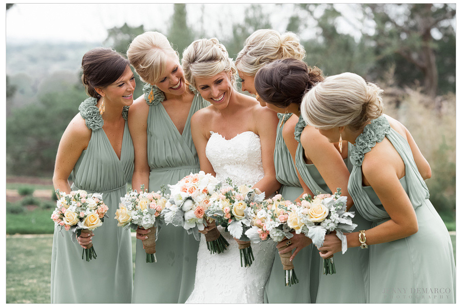 Bride's party gather together before Sacred Oaks wedding. Bridesmaids are wearing a soft green organza dresses.