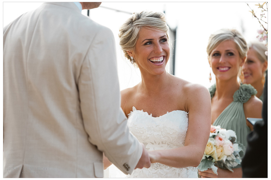 Bride and groom say their vows in their upscale Camp Lucy wedding.