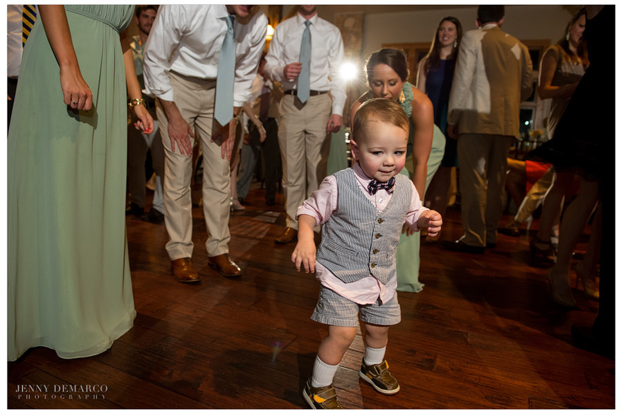 Adorable little boy dances in the open-air pavilion at Hill Country wedding.