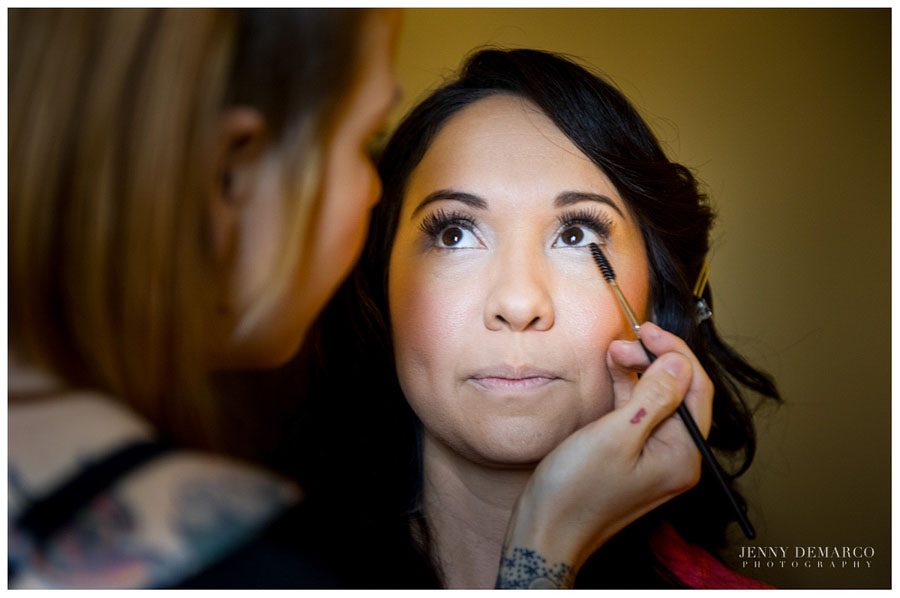 Bride having her makeup applied in the bridal suite and the historic driskill hotel in downtown austin.