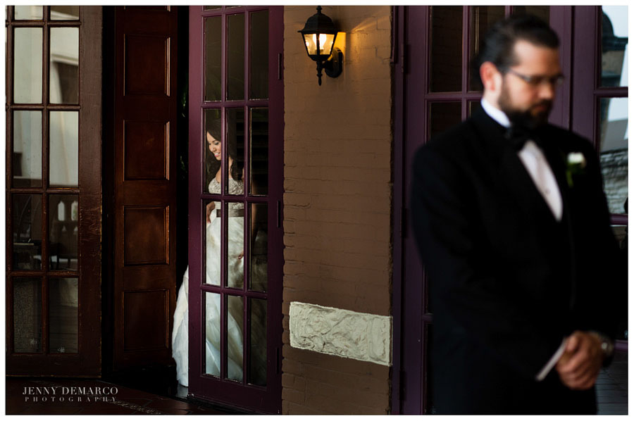 First look between the bride and groom on the hotel balcony by Austin Wedding Photographers